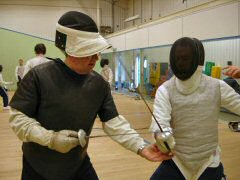 Tony Coton giving one to one fencing lesson
